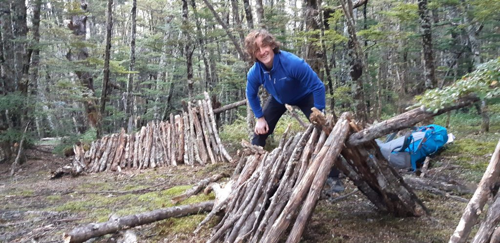 man building bivvy on bush craft course